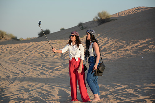 Tourist-Capturing-Selfie-with-Camera-In-Dubai-Desert-Safari